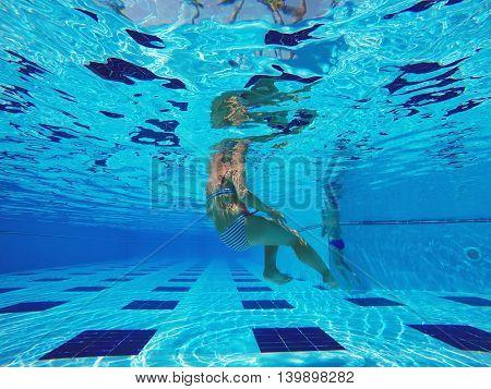 woman swimming in the pool