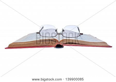 Old book and glasses isolated on white background with clipping path