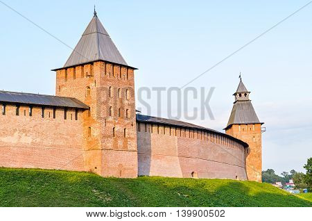 Prince tower and Saviour tower of Veliky Novgorod Kremlin Russia. Architecture landscape in sunny summer evening
