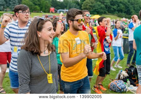 Poznan POLAND - JULY 24 2016: pilgrims praying dancing and singing during Days In Dioceses just before The World Youth Day in Krakow; WYD is a meeting of youth from all over the world