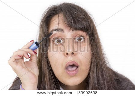 woman putting on make-up isolated on white background