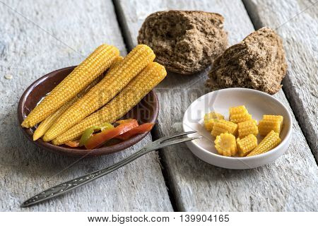 Marinated corn, bread, fork on the table