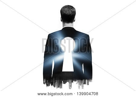 Businessman with keyhole in his back on dark city background. Double exposure