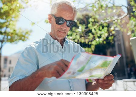 Tourist With A Map In City
