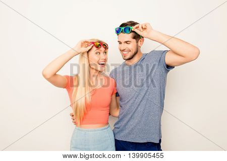 Young Cheerful Couple In Love With Glasses Huging Each Other