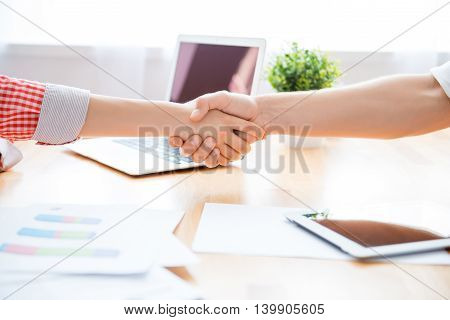 Close Up Of Man And Woman Giving Business Hand Shake