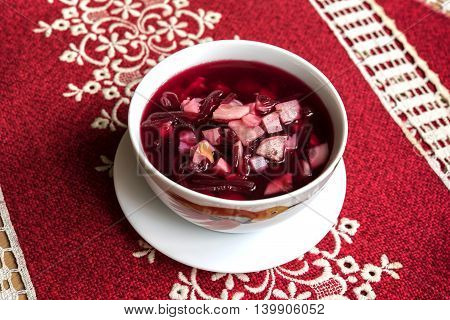 Beet soup in Russian cuisine on a red napkin