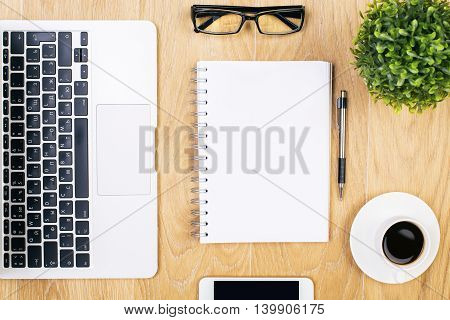 Notepad And Technology On Table