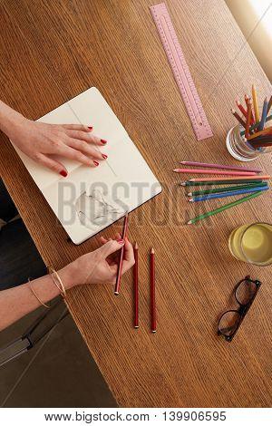 Woman Hands Making A Flower Sketch On Sketchbook