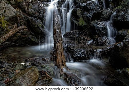 Waterfall. Beautiful view of a waterfall among cliffs in spring time
