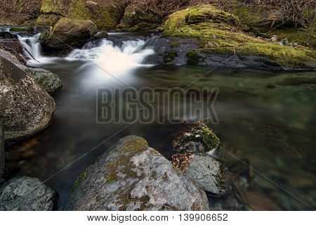mountain stream of clean water among the stones