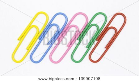 colored paper clips on a white background