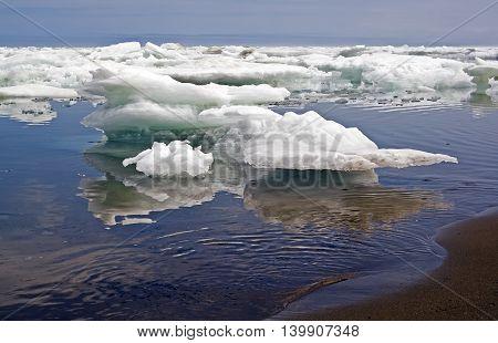 Blocks of ice on the coast of the frozen sea.