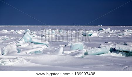the wreckage of the ice blue color of the sea