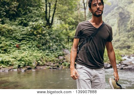 Young Man Crossing The Stream
