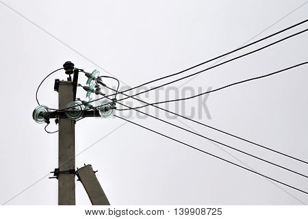 High-voltage electrical insulator electric line on a light background