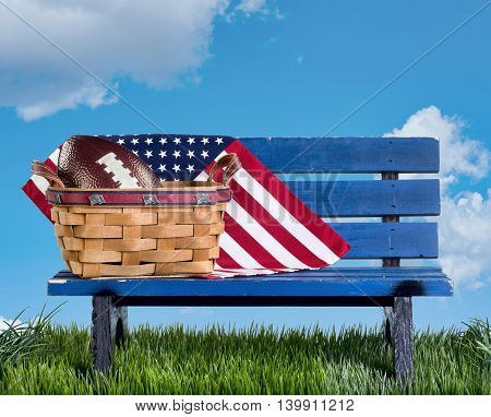 Blue park bench with handmade basketflag and football..