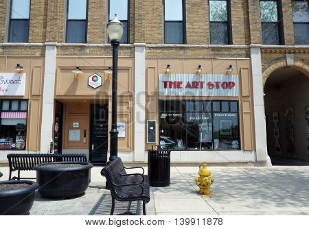 LA GRANGE, ILLINOIS / UNITED STATES - MAY 21, 2016: One may purchase fine art work at the Art Stop in downtown La Grange, Illinois.