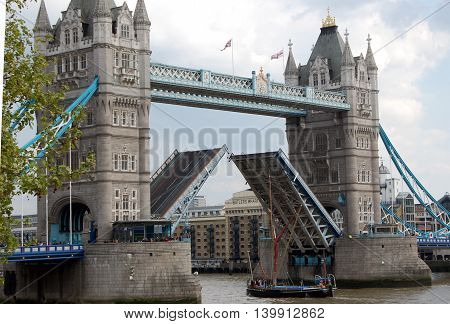London Tower Bridge opening lift vessel passing