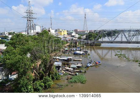 traditional boats in fishing village in saigon river ho chi minh city vietnam