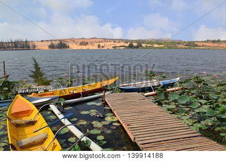 tourism boat in lotus bau trang lake muine vietnam