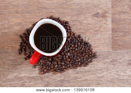 Woman holding a cup of hot coffee