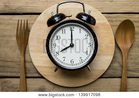 Meal time with alarm clock breakfast, concept and idea