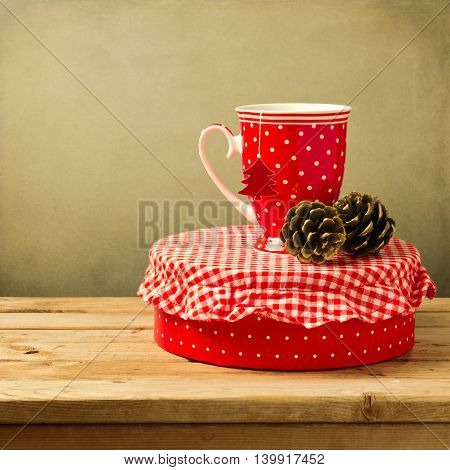 Christmas tea cup with gift box on wooden table