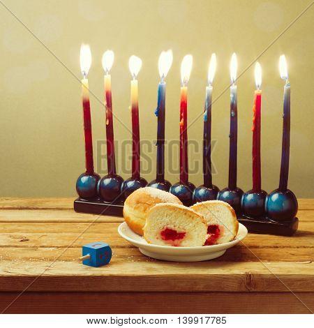 Jewish holiday Hanukkah celebration setting on wooden table