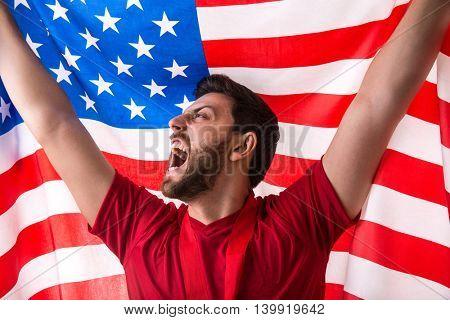 Athlete celebrating and holding the flag of USA