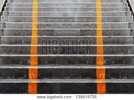 Abstract concrete stairs with yellow diving vertical lines