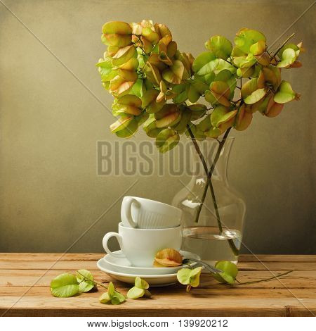 Vintage still life with autumn golden tree and coffee cups