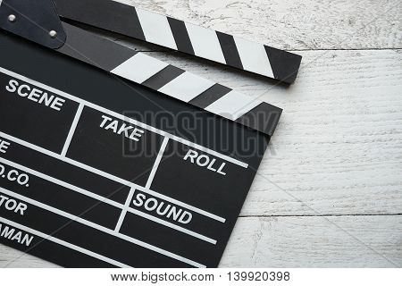 movie clapper on white old wood table
