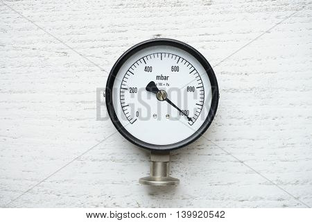 pressure gauge on white old wood background