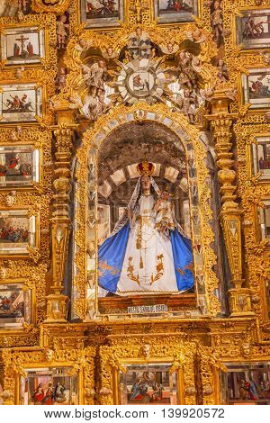 ATOTONILCO, MEXICO - DECEMBER 29, 2014 Mary Statue Golden Wall Sanctuary of Jesus Atotonilco Mexico. Built in the 1700s known as the Sistene Chapel of Mexico with Frescoes of Jesus Stories. Frescoes by Miguel Antonio Matinez between 1740 and 1775.