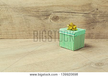 Vintage green gift box over wooden background