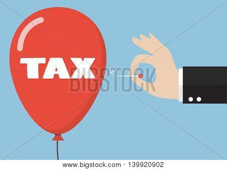 Hand pushing needle to pop the tax balloon. Business concept
