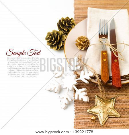 Christmas table setting with plate kine fork and decorations