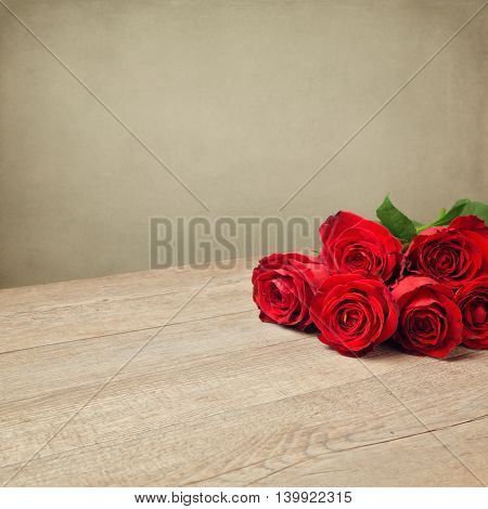 Romantic holiday background with beatiful red roses