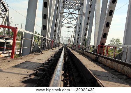 Railway metal bridge perspective view. Steel rail track