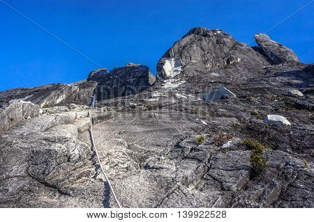 Ranau,Sabah,Borneo-March 13,2016:View of mountain Kinabalu Mountain with climbing rope on the summit at Mountain Kinabalu.There are two summit trails completed,Ranau Trail & Kota Belud Trail.