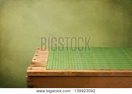 Retro background with empty wooden table and placemat