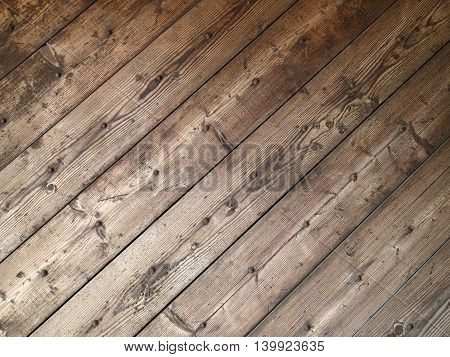 Diagonal texture of old wooden planks with rusty nails