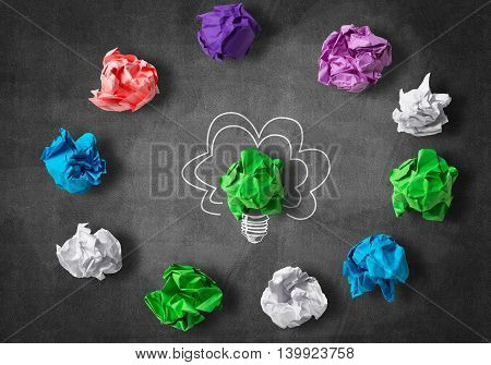 Inspiration concept with crumpled paper light bulb as good idea