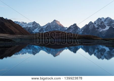 Beautiful mountain lake. Reflection of sky in water. Lake Koruldi. Caucasus, Georgia, Zemo Svaneti