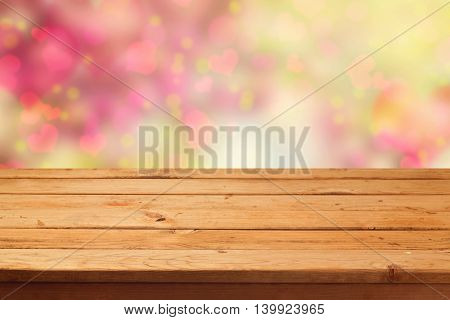 Dreamy background with empty table and heart shape bokeh