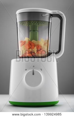 Combined Steamer & Blender with vegetables isolated on white