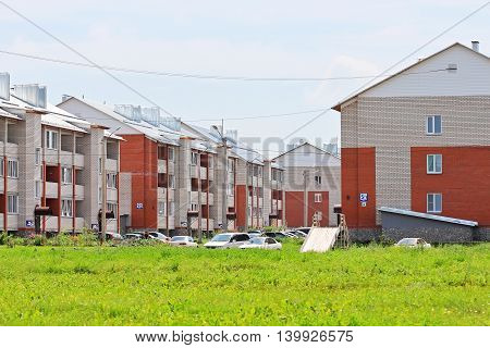 The town of Berdsk Microdistrict white stone Novosibirsk oblast Siberia Russia - July 22 2016: new residential district of the city of three-storey brick houses