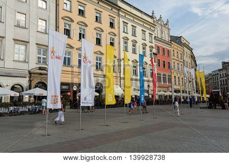 CRACOW POLAND - JULY 24 2016: Flags of World Youth Day 2016 on Main Square in Cracow. Poland