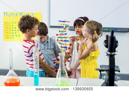 Children with scientific equipment in laboratory at school